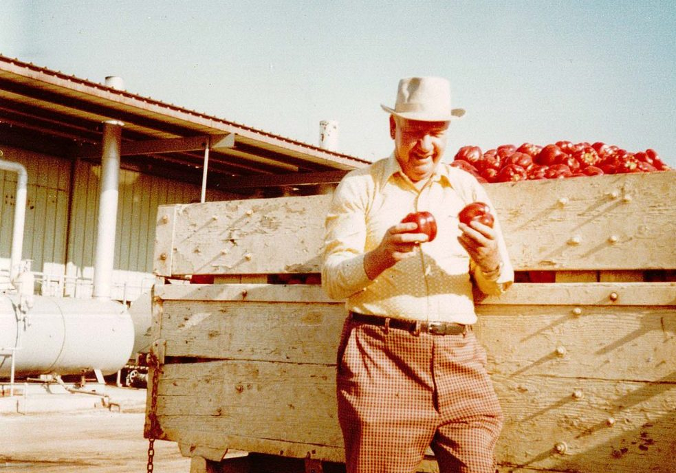 Moody Dunbar, Inc. Founder Moody Dunbar holding peppers